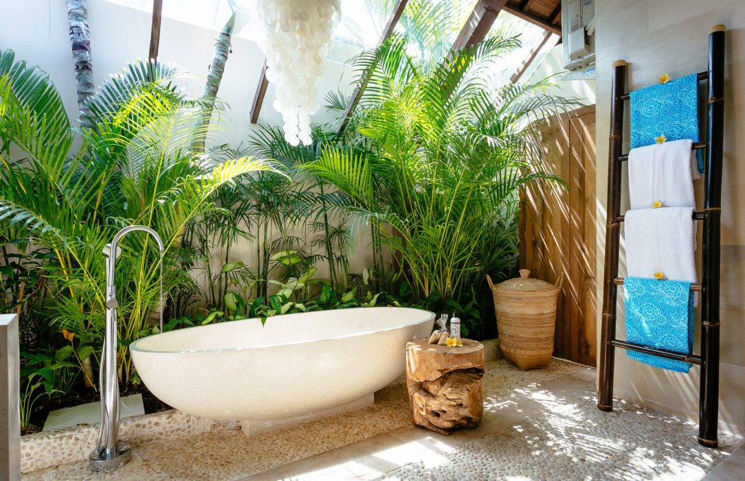 Seminyak Retreat Sanctuary Bathroom with Stone Bath- Bliss Sanctuary for Women At our beautifully appointed Seminyak sanctuary retreat we have an on-site yoga shala, two gorgeous outdoor living and dining spaces, daybeds around the sparkling pool, a beautiful shaded meditation pod to retreat into as well as an amazing tropical garden, with a massage bale overlooking the pool. So many poolside lounges and places to escape in this luxe environment for massages, meditation, sun-baking, reading and ultimate peace and relaxation.