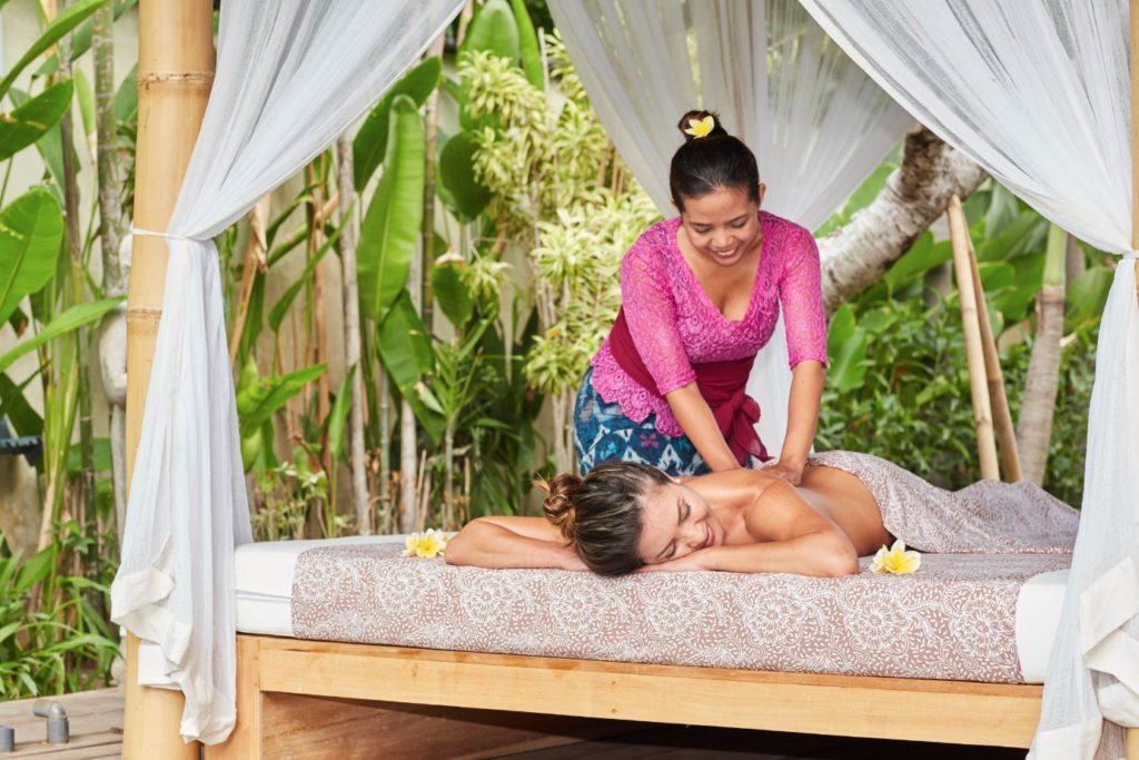 One of our massage staff treating a guest -  experience pure bliss with unlimited spa treatments with our personally trained staff and their amazing healing hands