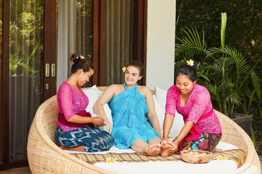 A guest being pampered - Unlimited spa treatments include manicures and pedicures when ever you feel like following your bliss. Enjoy your treatments by our beautiful pool and relax