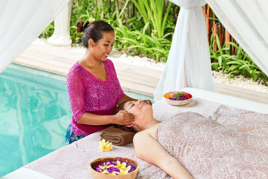 Guest enjoying a blissful treatment - indulge in unlimited spa treatments by our beautiful pool at our Bliss yoga and spa retreat