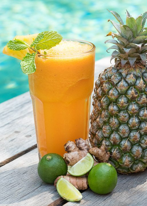 Gorgeous orange and pineapple smoothie next to the pool - be spoiled for choice at Bliss Yoga Retreat where food is unlimited