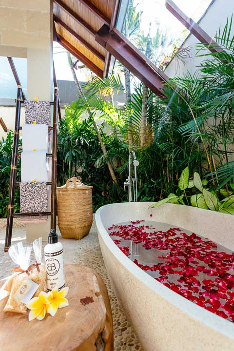 Stunning luxury bathroom with stone bath with rose petals, Bali retreat, Bliss Sanctuary For Women, Seminyak Sanctuary