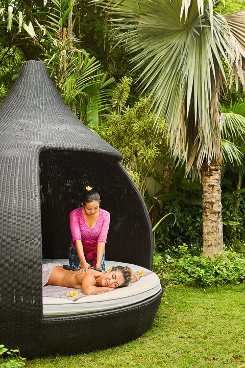 A woman being pampered   in beautiful outdoor setting - unlimited spa treatments at our Bali and spa retreat