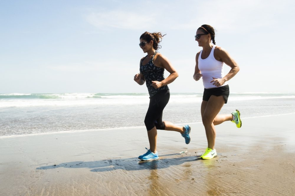 Women enjoying jogging on beautiful Bali beach with our Bliss Active Package