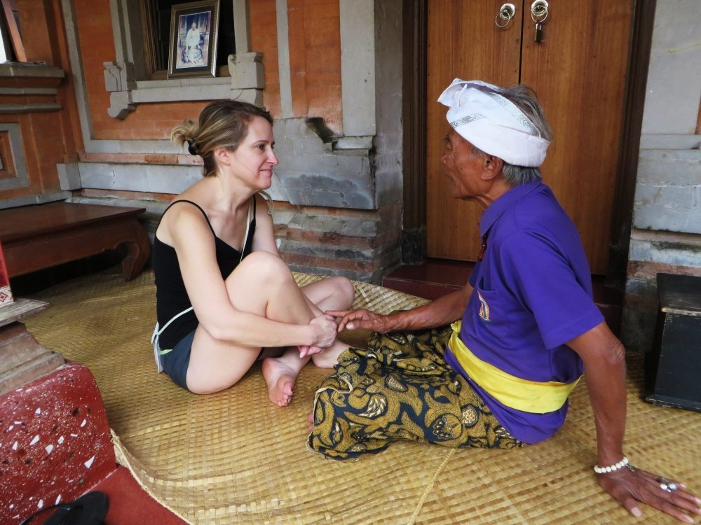 Ketut Liyer, the Balinese spiritual healer, treating a woman as part of the Eat, Pray, Love Package at Bliss Bali health & wellbeing retreat