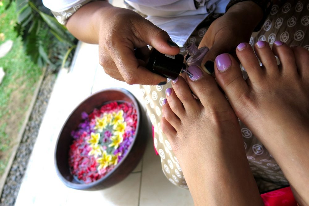 Woman having a pedicure - Unlimited spa treatments include manicures and pedicures when ever you feel like following your bliss. Enjoy your treatments by our beautiful pool and relax
