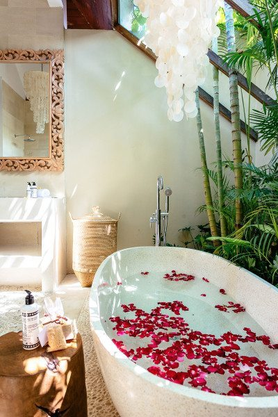 Stunning luxury bathroom with stone bath and rose petals, Bali retreat, Bliss Sanctuary For Women, Seminyak Sanctuary
