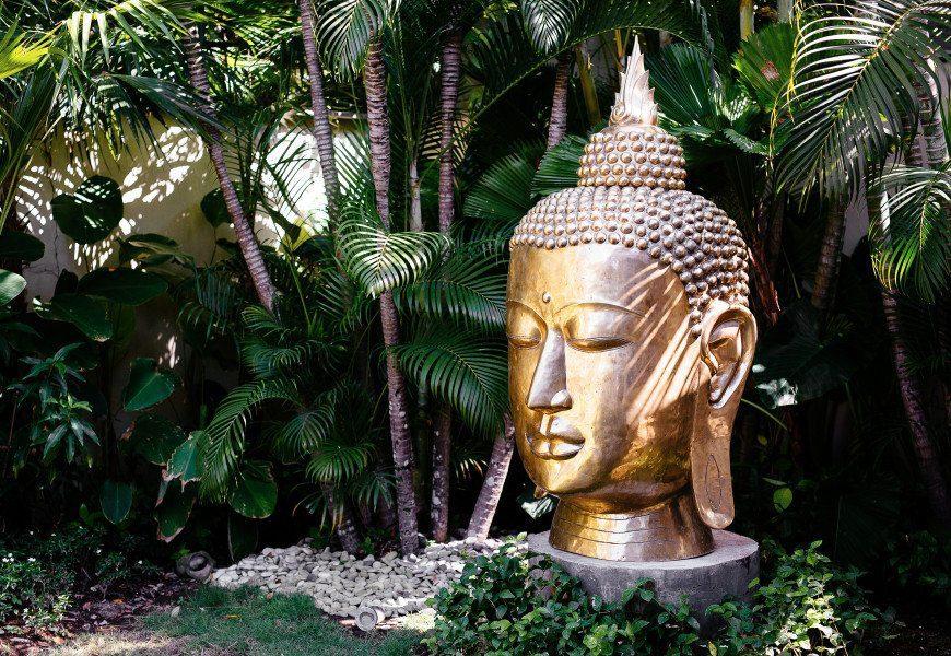 Beautiful huge buddha in lush green garden at Bali retreat, Bliss Sanctuary for Women in Seminyak, Bali
