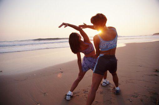 Women performing yoga on a beautiful Bali beach