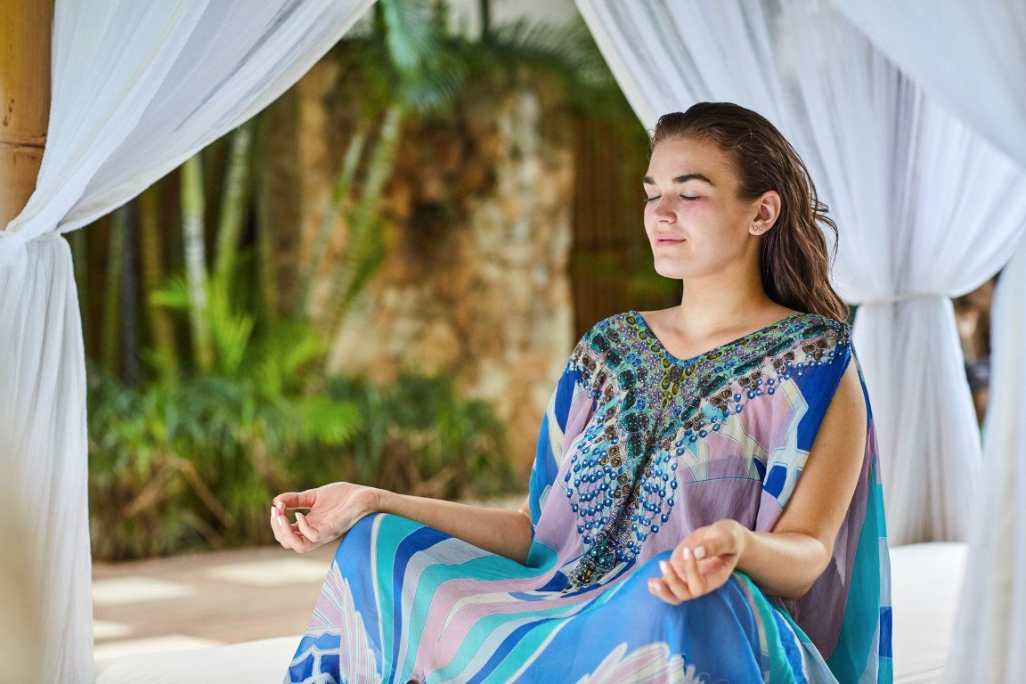 Women mediating in beautiful surrounds. Bliss Sanctuary Mediation Retreat Package.