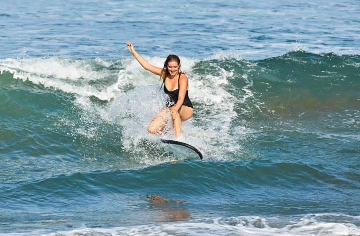 Women surfing during one on one surf lesson on our Retreat Surf Package in Bali