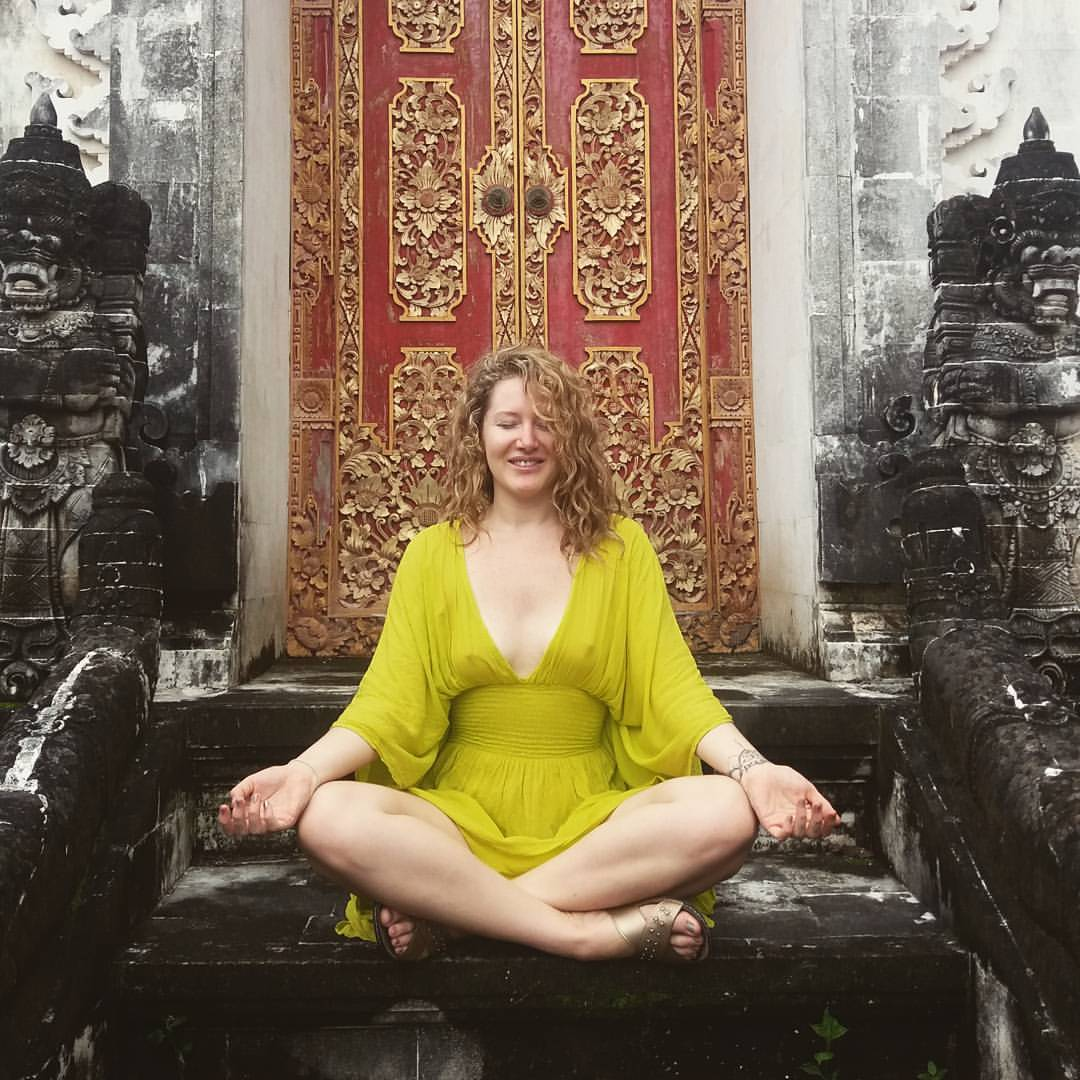 Women on Bliss Sightseer Package mediating at a temple. Experience the real Bali and its culture and traditions