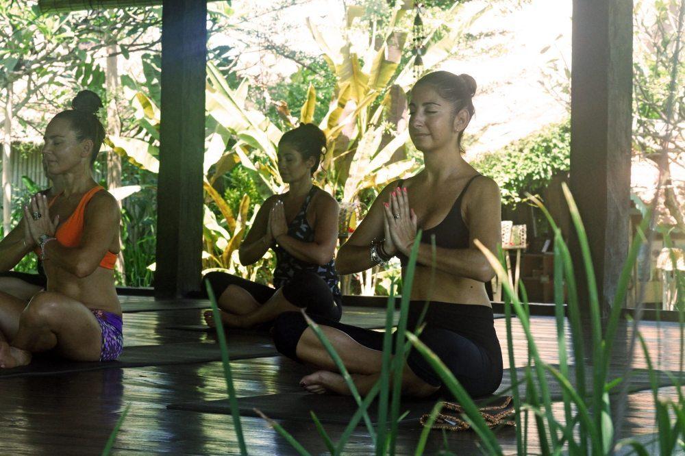 Women mediating in beautiful surrounds. Bliss Sanctuary Mediation Retreat Package.