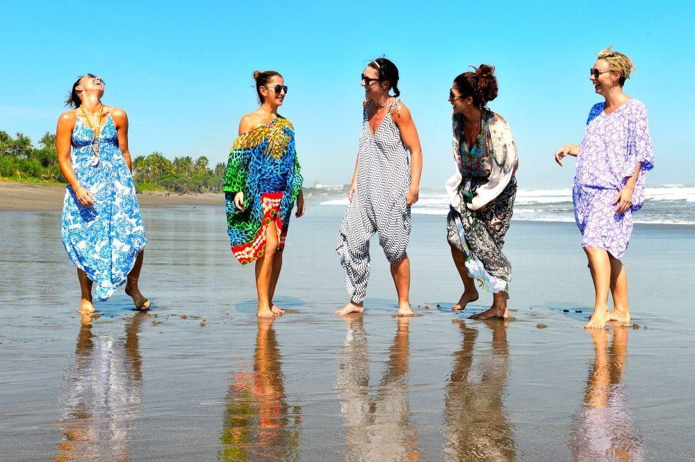 Women enjoying Bali beach in sunshine