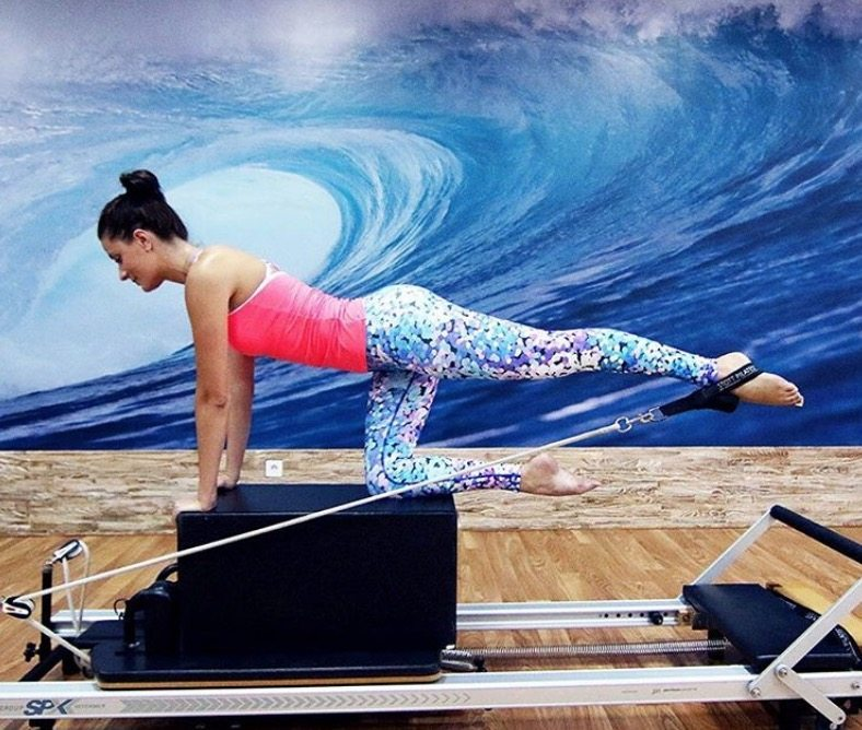 guest doing pilates at Bali retreat