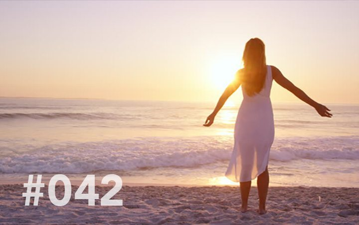 Blog 042 – The Power of Surrender - girl on the beach arms outstretched