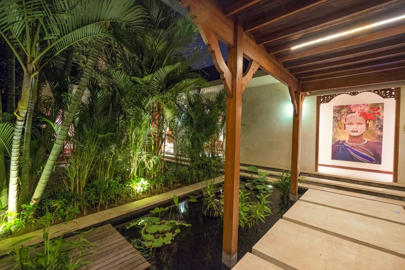 Bali retreats, Beautiful Bliss Sanctuary For Women, New Canggu Sanctuary, relaxing beautiful pond walkway, stunning artwork
