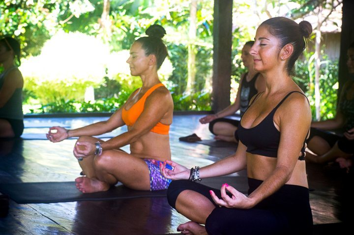 Women relaxing during yoga session at Bliss yoga and spa retreat in Bali