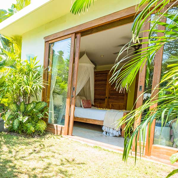 Glass sliding doors from gorgeous green garden to luxury bedroom, Bliss Retreat Room, Bliss Sanctuary For Women, Canggu