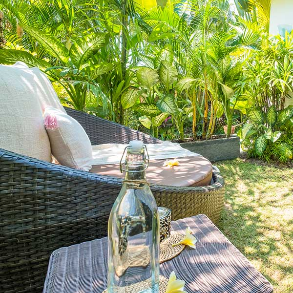 Sunlounge in lush green garden in Bali retreat, Bliss Retreat Room, Bliss Sanctuary For Women, Canggu