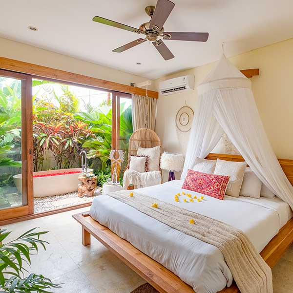 Luxury bedroom with outdoor rose petal stone bath bed with flower in Bali retreat, Garden Bath Retreat Room, Bliss Sanctuary For Women, Canggu