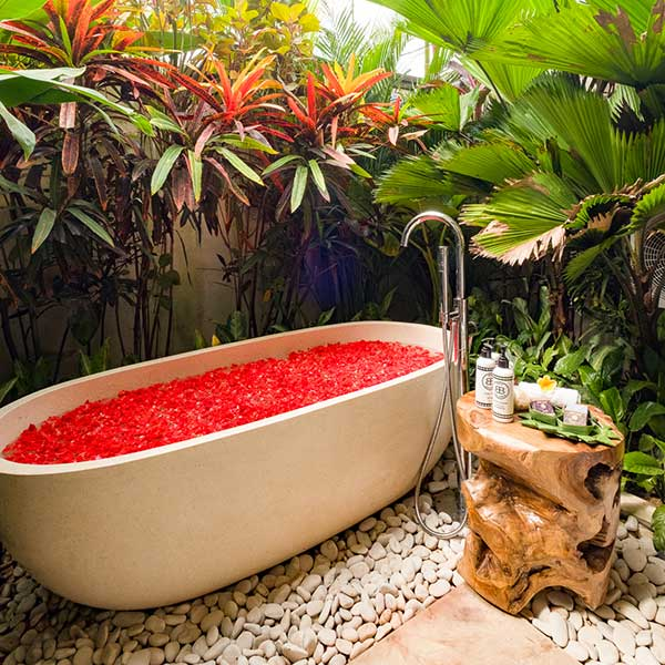 Gorgeous outdoor stone bath filled with rose petals Bali retreat, Garden Bath Retreat Room, Bliss Sanctuary For Women, Canggu