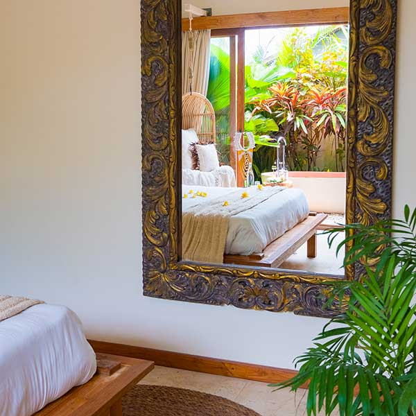 Stunning ornate mirror shows gorgeous luxury bedroom in garden setting in Bali retreat, Garden Bath Retreat Room, Bliss Sanctuary For Women, Canggu