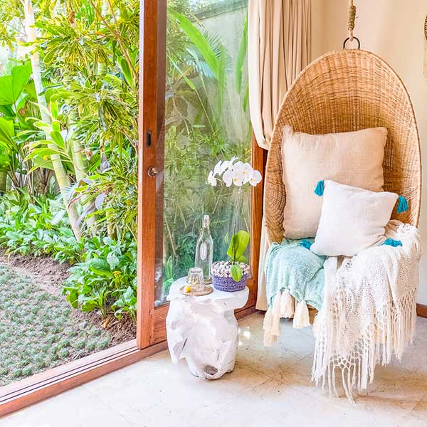 Relaxing hanging chair and lush green garden in Bali retreat bedroom, Bliss Retreat Room, Bliss Sanctuary For Women, Canggu