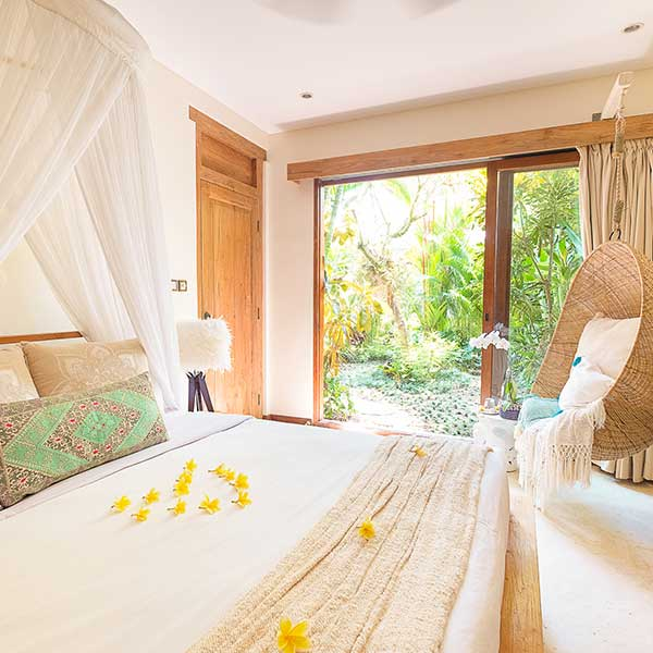 Bali retreat bedroom with relaxing hanging chair and beautiful lush green garden, Bliss Retreat Room, Bliss Sanctuary For Women, Canggu