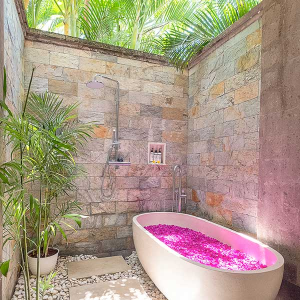 Rose petal stone bath in beautiful luxury outdoor bathroom in Bali retreat, Bliss Retreat Room, Bliss Sanctuary For Women, Canggu