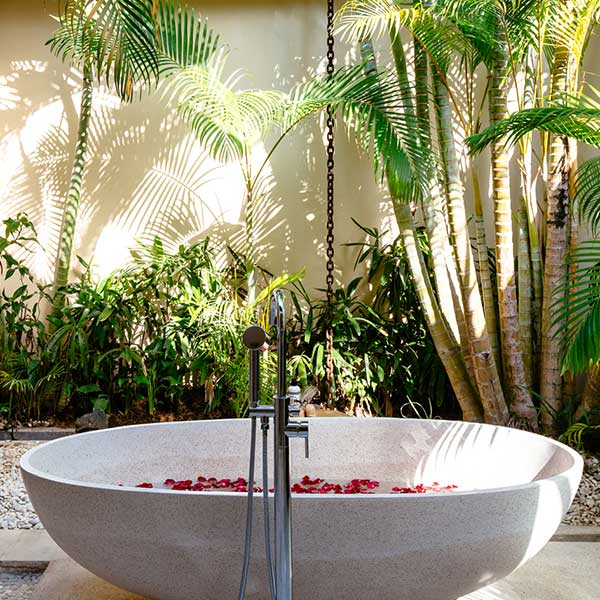 Luxury rose petal stone bath in beautiful outdoor bathroom in Bali retreat, King Deluxe Pool Room with Loft, Bliss Sanctuary For Women, Canggu