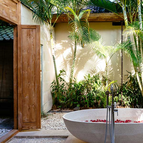 Beautiful outdoor bathroom with luxury rose petal stone bath in in Bali retreat, King Deluxe Pool Room with Loft, Bliss Sanctuary For Women, Seminyak