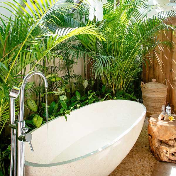 Lush garden setting for stone bath in beautiful bathroom in Bali retreat, Garden Retreat Room Bliss Sanctuary For Women, Seminyak