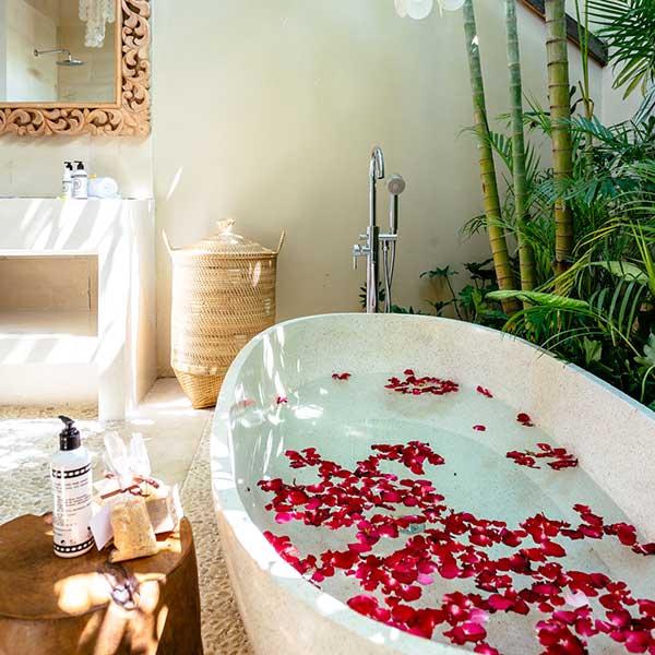 Luxurious rose petal stone bath in deluxe bathroom in Bali retreat, King Size Pool Room, Bliss Sanctuary For Women, Seminyak