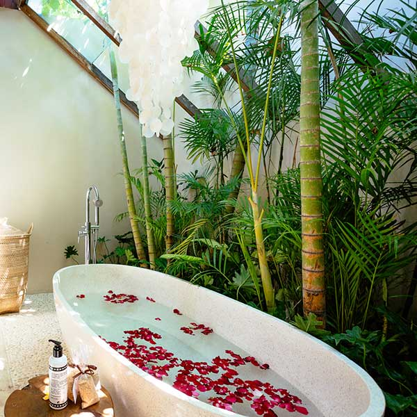 Gorgeous luxury bathroom with rose petal bath in lush garden setting in Bali retreat, King Size Pool Room, Bliss Sanctuary For Women, Seminyak