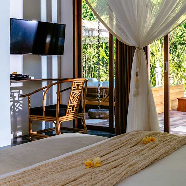 Luxury bedroom overlooks lush green garden in Bali retreat, King Deluxe Pool Room with Loft, Bliss Sanctuary For Women, Seminyak