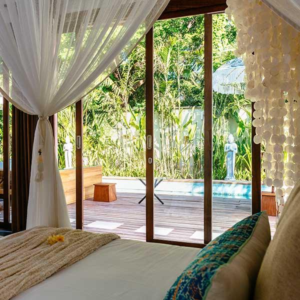 Luxury bedroom overlooks beautiful pool in Bali retreat, King Deluxe Pool Room with Loft, Bliss Sanctuary For Women, Seminyak