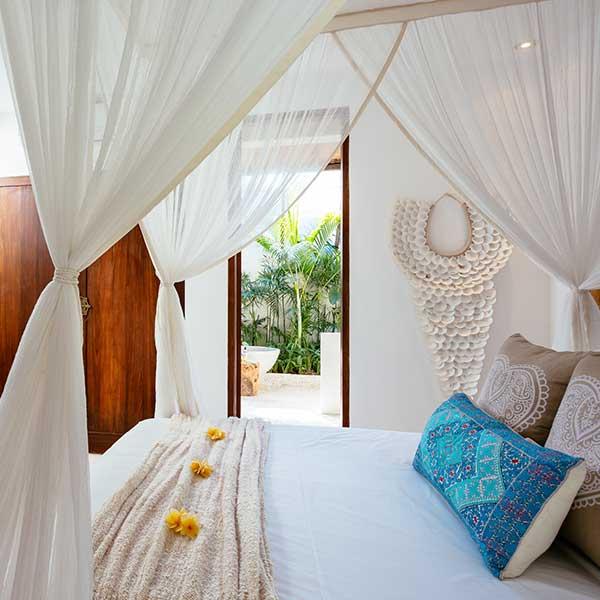 Beautifully decorated luxury bedroom overlooking lush garden in Bali retreat, Garden Retreat Room, Bliss Sanctuary For Women, Seminyak