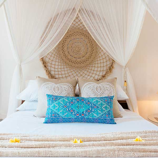 Beautifully styled King bed with mosquito net in luxury bedroom in Bali retreat, Garden Retreat Room, Bliss Sanctuary For Women, Seminyak