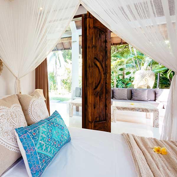 Luxury bedroom overlooks gorgeous tropical garden with gold buddha head, Garden Retreat Room, Bliss Sanctuary For Women, Seminyak