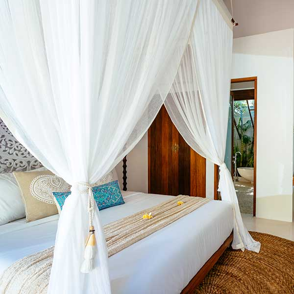 Beautifully styled King bed with mosquito net in luxury bedroom in Bali retreat, King Sized Pool Room, Bliss Sanctuary For Women, Seminyak