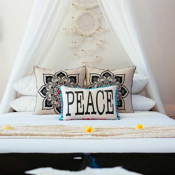 Peaceful relaxing bed setting in luxury Bali Retreat bedroom, Poolside Double Room, Bliss Sanctuary For Women, Seminyak