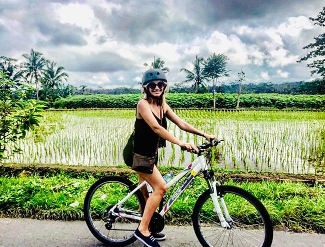Bliss Bali retreat for women eat pray love girl on bike