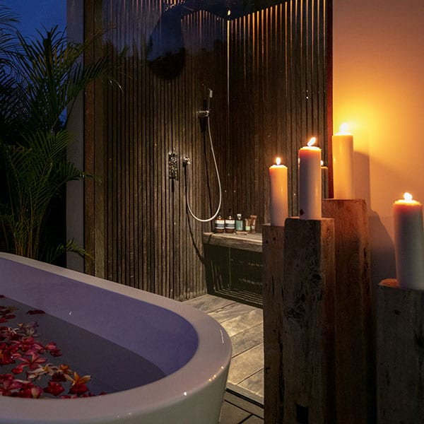 Beautiful outdoor flower bath with candles in Ubud Sanctuary Bali Retreat