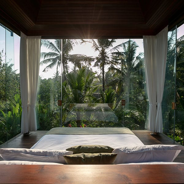 Bedroom surrounded by glass in luxury Bali Retreat