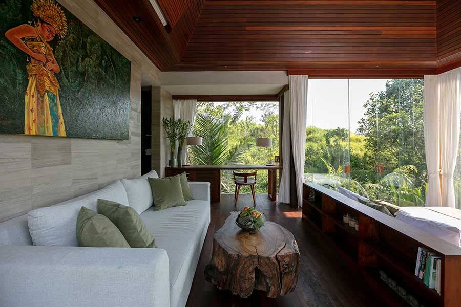 Couch in luxury bedroom garden setting Ubud Bali resort