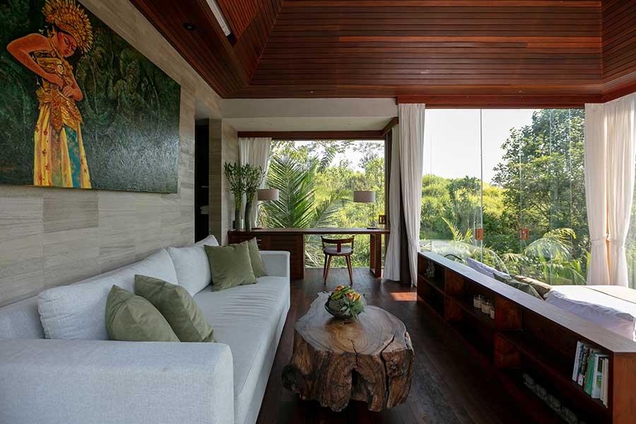 Couch in luxury bedroom garden setting Ubud Bali resort