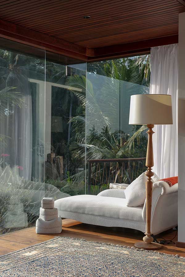Day bed with stunning garden outlook glass walls best spa in Ubud