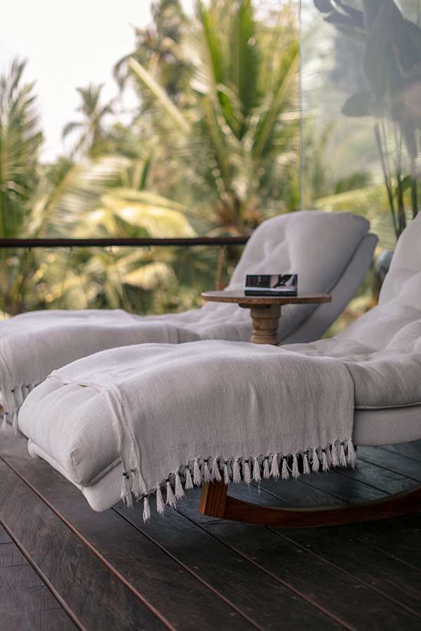 Deluxe chillout deck chairs on balcony Ubud Bali resort