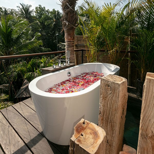 Relaxing outdoor flower bath Ubud Sanctuary Bali Retreat